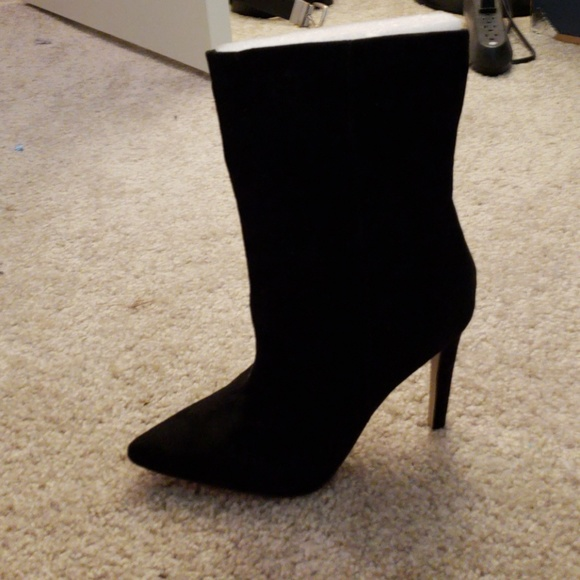 1aa5f4b4afd High heel boots. Never worn. Too small